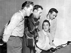 """""""""""The Million Dollar Quartet"""""""" in Memphis studio, 1956. Jerry Lee Lewis, Carl Perkins, Elvis Presley (on piano) and Johnny Cash."""
