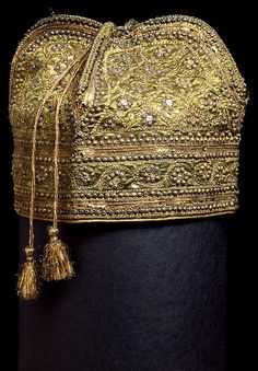 Hat, made in Burhanpur mid 19th century --  Satin, decorated with sequins, tinsel, silver and gold beads.   Courtesy of V Museum