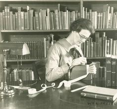 Title WPA Project Number 123 - Book repair at the Enoch Pratt Free Library in Baltimore, worker using a stylus to apply lettering to a finished book