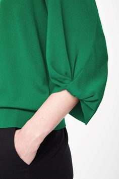 Gathered sleeve knit top