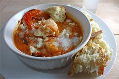Garides Saganaki (Shrimp Saganaki)  Ingredients: 1 tablespoon olive oil 1/4 cup onion (chopped) 1/4 teaspoon red pepper flakes 1 clove garlic (chopped) 1/2 cup tomato (chopped) 1/4 teaspoon oregano 1 splash ouzo (or mastic liqueur, optional) salt and pepper to taste 1/4 pound shrimp 1 handful parsley (chopped) 1/2 cup feta (crumbled)