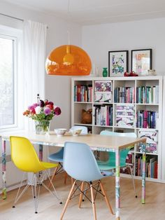 Lovely colour combinations and a bookshelf that also works as the perfect space-divider. Via milkmagazine.net