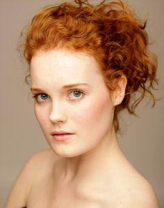 Fair skin, orange-brown hair