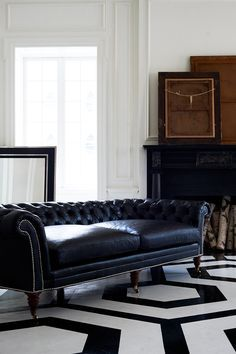 The Brook Street Tufted Sofa: This Chesterfield sofa is masculine in style and boasts deep and low proportions.