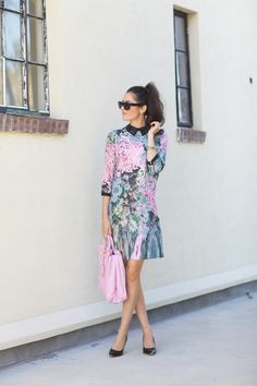 The black collar on this floral print dress makes this look worthy of a winter wedding.
