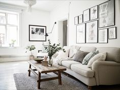 Lovely and bright living room. Howard sofa, picture wall and grey carpet.