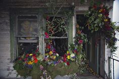 Then a Detroit Abandoned House, Now a Temporary Art Installation of 36000 Flowers. l Photo Heather Saunders l #flowers #artinstallation