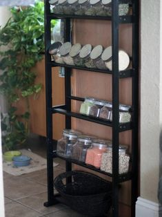 You'll save money on spices if you buy bulk, but where to store those cups of clove and peppermint? Find an inexpensive open shelf unit that has space for glass canisters. Blogger Vanessa Alvarado upcycled this black shelf to create an in-home apothecary filled with herbs and dried goods.