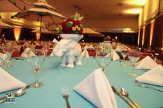 Simple table setting with elephant vase centerpiece and robins egg blue linens. Moroccan Theme, Vase Centerpieces, Robins Egg, Event Planning, Linens, Table Settings, Elephant, Table Decorations, How To Plan