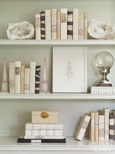 A place for everything...gorgeous bookcases styled by Cheryl and Alison Womack. Via Atlanta Homes and Lifestyle.