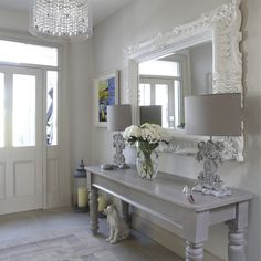 shabby chic style hall white elegant mirror glamorous glass lamp flower pot two exotic table lamps colourful painting of Enviable Mirrored Entryway Table