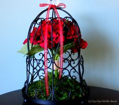 Decorative Black Birdcage with Red Silk Flowers and Crystal Bird from byebyebirdiedecor.etsy.com $68