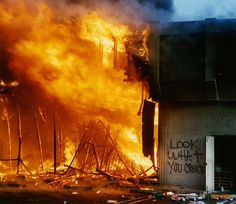 1992 Los Angeles riots - mall goes up in flames, someone spray-painted a statement about violence.