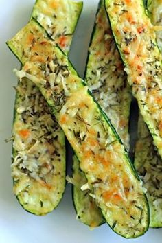 crusty parmesan-herb zucchini bites 4 medium, fresh zucchini, sliced in half cup fresh Parmesan cheese, grated tablespoons fresh rosemary & thyme, minced smidge of olive oil salt & pepper to taste Directions Pre-heat oven to Vegetable Recipes, Vegetarian Recipes, Cooking Recipes, Healthy Recipes, Easy Recipes, Cookbook Recipes, 21dayfix Recipes, Cooking Food, Fudge Recipes