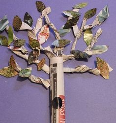 This tree collage is made out of craft materials that can be recycled from around the house.