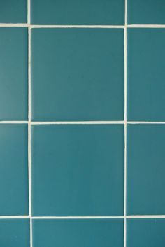Peacock wall tiles from the Johnsons Prismatics range