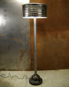 For those who like the industrial look, here's a lamp made from recycled parts.  I'm not sure how long this trend will last ... what do you think?  55 Gallon drum light made from a recycled fire hydrant and grape-juice drum