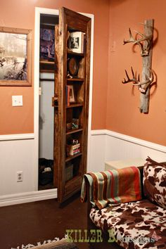 hidden closet behind a built in bookcase @Melissa Royer  Maybe Daddy can help you with this one!!!