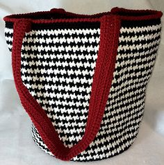 "This is a pattern for a large houndstooth tote bag with finished dimensions of a full sized bag being 12"" tall (+handle) and has an approximate circumference of 37"". The pattern does have instructions for making the bag smaller or larger."