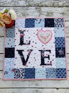 Floral Love Mini Quilt | This fun DIY Valentine's Day quilt can be made in just a few hours!