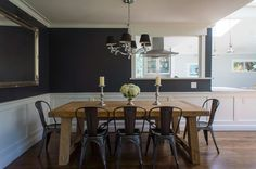 Fun mix of farmhouse/rustic dining table with vintage/industrial metal chairs.