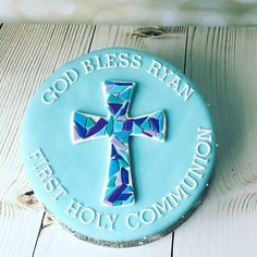 Mosaic Cross Communion Cake! Vanilla Cake filled with Delicious Chocolate Pudding and Covered in Fondant. The Cake is Decorated with a Mosaic Cross and Hand Piped Swiss Dots! #communioncake #mosaic #mosaiccross #handmade#swissdots #royalicing #fondantcake #fondant#custommade#customcakes#cakestagram #cross#crosscake#holycommunion #zaisdessertery #dumont#dumontnj#nj#ny#chocolatepudding #chocolatepuddingfilling #cakefilling #ny#bakedwothlove#bergencounty#bergencountynj #bakermom#dumontmom
