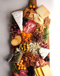 The Ultimate Holiday Charcuterie Board Wow your guests at the season's holiday parties and dinners with our Ultimate Holiday Charcuterie Board. We've filled ours with almonds, pecans and walnuts and added crackers, cheese, fruit. Antipasto, Crudite, Charcuterie And Cheese Board, Charcuterie Platter, Cheese Boards, Party Food Platters, Party Trays, Cheese Fruit Platters, Cheese Platers