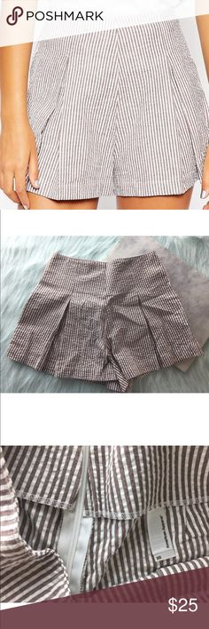 """American Apparel Seersucker Hampton Pleated Shorts American Apparel White Brown Seersucker Hampton High Waist Pleated Shorts Condition: Excellent; like-new; no flaws  Approximate measurements taken flat: Waist: 12.5"""" Rise: 14"""" Inseam: 2"""" American Apparel Shorts"""