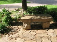 Did-It-Herself project. Our chief marketing officer installed this simple flagstone patio and stone bench so she could enjoy her shade garden.