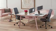 bivi modular desk system in pink finish with 2 desks and rumble seat attachments, fabric tackboard screens, and Massaud conference chair in grey
