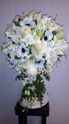 The purity of white with a touch of black in the anemone makes this cascade pop.
