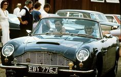 In this undated photo, Prince Charles and Princess Diana are seen driving away in the Prince's blue Aston Martin.