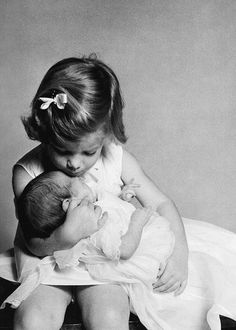 Caroline Kennedy and her six week old brother, John F. Kennedy, Jr. at the Kennedy compound in Palm Beach, Florida on January 3, 1961. -- Photo by Richard Avedon