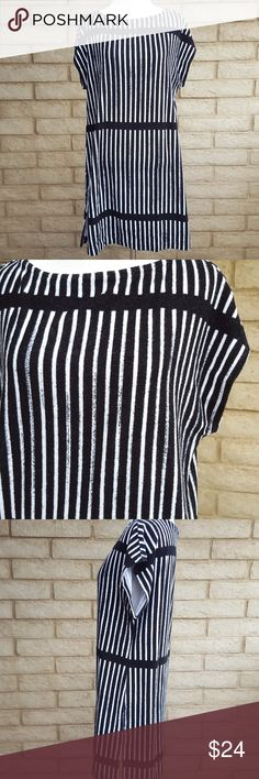 """Marimekko Target Striped Terry Cloth Textured Top Marimekko For Target Small Black & White Striped Terry Cloth Textured Tunic Top Shirt   Care: Please see photos for the fabric care / content details.  Condition / Items to Note: Long tunic with side slits. Slight terry cloth texture with some fuzziness. Fabric is in good condition with normal signs of wear/washing. Some wash wear.  Approximate Measurements: Bust 19.5"""", Length 32"""". These measurements were taken with garment lying flat, side…"""