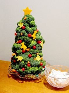 Kinda want to make this! Broccoli on toothpicks stuck into a styrofoam cone.  Then add cheese, tomato, and carrot accents.