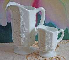 Hand Made Westmoreland Milk Glass Pitchers with Embossed Leaves and Grapes Pattern. Two Westmoreland Footed Ornate Pitchers with Grapes.