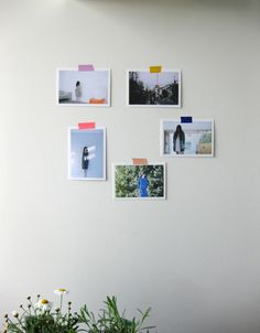 Sweet & simple decorating idea: post photos on the wall with washi tape.