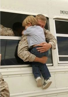 Soldier hugging his child