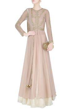 Malasa champagne color flared kalidaar anarakli in georgette and net base hand embroidered with gold sequins and tar work in floral pattern on the front yoke and sleeves. It is paired with cream silk base flared lehenga skirt and dupatta with gold embroidered border.