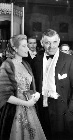 Grace Kelly and Clark Gable arrive at the 26th annual Academy Awards at the RKO Pantages Theatre in 1954 by Ed Clark