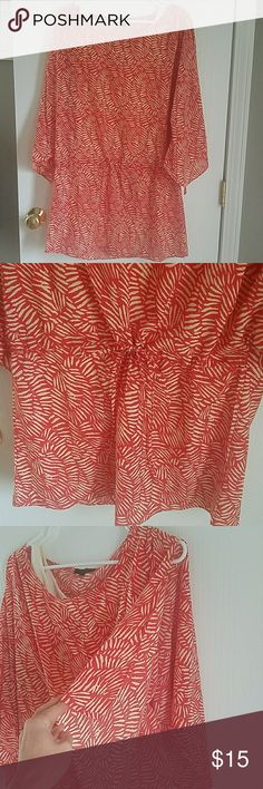 Flowy Summer Dress Fun, boutique-style dress! Flowy sleeves that split open at the shoulder. Cream slip layer. Cinches at waist/hip. Worn twice! Made of polyester (slip is spandex). Color is coral/red. Lovposh Dresses Mini