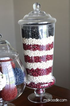 Layer white northern beans, red kidney beans and black beans in an apothecary jar for a festive 4th of July decoration