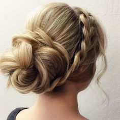 Battling the hot and humid months in Texas is always a challenge. Instead of blow drying and straightening, why not beat the heat with a casual braided updo that keeps you cool and stylish through the summer! Step 1:Gather your hair into a ponytail just above the nape of your neck, holding it in place with one hand. Using the other hand, carefully brush your hair backwards leaving one front piece outside the ponytail. Step 2: Secure your low pony with a hair tie. Wrap your hair clockwise…