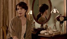 Cora at her dressing table. Lovely green dressing gown
