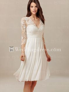 Lovely short wedding dress features in Tulle and Chiffon. The bodice is adorned with vintage lace with scalloped edge along the V-neckline.