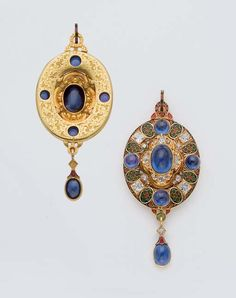 AN ANTIQUE ENAMEL, SAPPHIRE, DIAMOND AND GOLD PENDANT. Typically oval in shape set with a large central carbuncle or cabochon, surrounded by a border of polychrome champeré enamel, spaced with stone highlights. Supporting a stone set drop, the reverse finely engraved with foliate patterns. ca. 1870