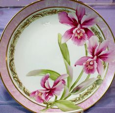 "10"" hand painted porcelain plate, signed and features orchids with Victorian styling. 14K gold accents...$68.00 + $11.50 shipping."