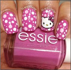 Pink and white polka dot nail art with Hello Kitty accent finger My middle daughter would love this!