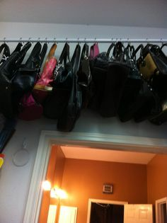 Purses hung using shower curtain rod/hooks. #closet organization