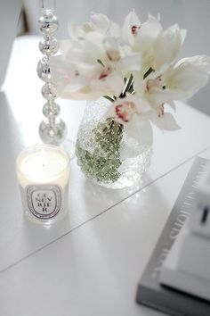 Orchids + Diptyque candle